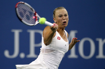 NEW YORK, NY - SEPTEMBER 05: Caroline Wozniacki of Denmark hits a forehand against Svetlana Kuznetsova of Russia during Day Eight of the 2011 US Open at the USTA Billie Jean King National Tennis Center on September 5, 2011 in the Flushing neighborhood of