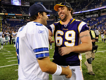 MINNEAPOLIS, MN - AUGUST 27: Tony Romo #9 of the Dallas Cowboys and Jared Allen #69 of the Minnesota Vikings speak after the game on August 27, 2011 at Hubert H. Humphrey Metrodome in Minneapolis, Minnesota. (Photo by Hannah Foslien/Getty Images)