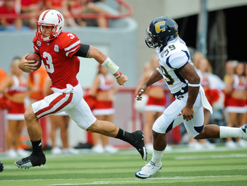LINCOLN, NE - SEPTEMBER 03: Taylor Martinez #3 of the Nebraska Cornhuskers runs to the endzone past Keith Mayes #39 of the Chattanooga Mocs during their game at Memorial Stadium September 3, 2011in Lincoln, Nebraska. Nebraska won 40-7. (Photo by Eric Fran
