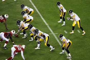 TAMPA, FL - FEBRUARY 01:  Quarterback Ben Roethlisberger #7 of the Pittsburgh Steelers stands at the line behind (top to bottom) Willie Colon #74, Darnell Stapleton #72, Justin Hartwig #62, Chris Kemoeatu #68, Max Starks #78 and Heath Miller #83 against t
