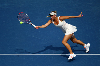 NEW YORK, NY - SEPTEMBER 03:  Caroline Wozniacki of Denmark returns a shot against Vania King of the United States during Day Six of the 2011 US Open at the USTA Billie Jean King National Tennis Center on September 3, 2011 in the Flushing neighborhood of