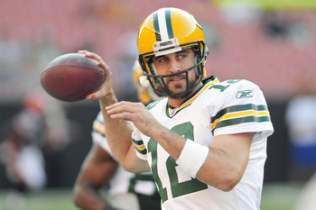 CLEVELAND, OH - AUGUST 13: Starting quarterback Aaron Rodgers #12 of the Green Bay Packers warms up prior to the game between the Cleveland Browns and the Green Bay Packers at Cleveland Browns Stadium on August 13, 2011 in Cleveland, Ohio. (Photo by Jason