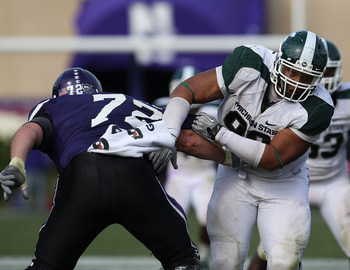 EVANSTON, IL - OCTOBER 23: Jerel Worthy #99 of the Michigan State Spartans moves past a block attempt by Brian Mulroe #72 of the Northwestern Wildcats at Ryan Field on October 23, 2010 in Evanston, Illinois. Michigan State defeated Northwestern 35-27. (Ph