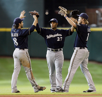 HOUSTON - SEPTEMBER 04:  Ryan Braun #8, Jerry Hairston, Jr. #27 and Corey Hart #1 of the Milwaukee Brewers celebrate after the final out as they defeat the Houston Astros 4-0 at Minute Maid Park on September 4, 2011 in Houston, Texas.  (Photo by Bob Levey