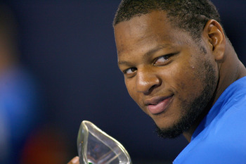 ORCHARD PARK, NY - SEPTEMBER 01:  Ndamukong Suh #90 of the Detroit Lions sits on the sidelines against the Buffalo Bills at Ralph Wilson Stadium on September 1, 2011 in Orchard Park, New York.  (Photo by Rick Stewart/Getty Images)