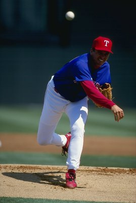 8 Mar 1999:  Pitcher John Burkett #33 of the Texas Rangers pitching the ball during the Spring Training game against the Tampa Bay Devil Rays at the Charlotte County Stadium in Port Charlotte, Florida. The Rangers defeated the Devil Rays 6-4. Mandatory Cr