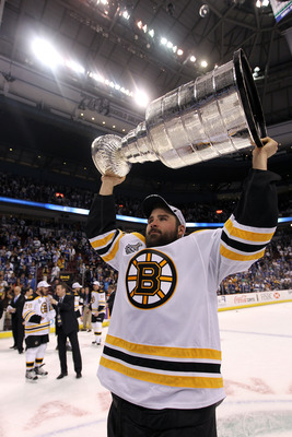 VANCOUVER, BC - JUNE 15:  Johnny Boychuk #55 of the Boston Bruins celebrates with the Stanley Cup after defeating the Vancouver Canucks in Game Seven of the 2011 NHL Stanley Cup Final at Rogers Arena on June 15, 2011 in Vancouver, British Columbia, Canada