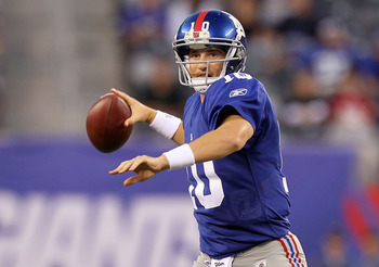 EAST RUTHERFORD, NJ - AUGUST 29:  Eli Manning #10 of the New York Giants throws pass against the New York Jets during their pre season game on August 29, 2011 at MetLife Stadium in East Rutherford, New Jersey.  (Photo by Jim McIsaac/Getty Images)