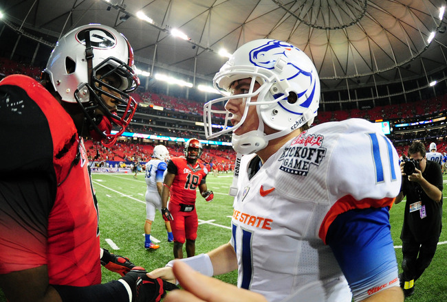 ATLANTA - SEPTEMBER 3: Kellen Moore #11 of the Boise State Broncos greets a member of the Georgia Bulldogs after the Chick-Fil-A Kickoff Game at the Georgia Dome on September 3, 2011 in Atlanta, Georgia. (Photo by Scott Cunningham/Getty Images)
