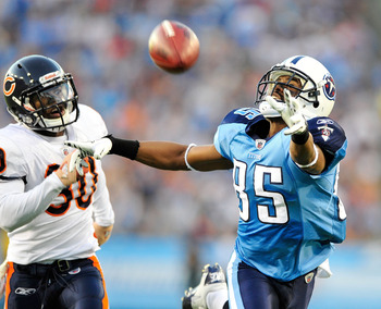 NASHVILLE, TN - AUGUST 27:  Nate Washington #85 of the Tennessee Titans stretches for an overthrown pass as D.J. Moore #30 of the Chicago Bears defends during a preseason game at LP Field on August 27, 2011 in Nashville, Tennessee.  (Photo by Grant Halver