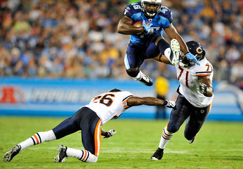 NASHVILLE, TN - AUGUST 27:  Ahmard Hall #45 of the Tennessee Titans hurdles Tim Jennings #26 and Israel Idonije #71 of the Chicago Bears during a preseason game at LP Field on August 27, 2011 in Nashville, Tennessee.  (Photo by Grant Halverson/Getty Image