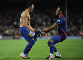 BARCELONA, SPAIN - AUGUST 29:  Alexis Sanchez of FC Barcelona celebrates with his teammate Thiago Alcantara after scoring his third team's goal during the La Liga match between FC Barcelona and Villarreal CF at Camp Nou on August 29, 2011 in Barcelona, Sp
