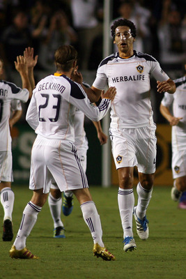 CARSON, CA - AUGUST 06:  Omar Gonzalez #4 of the Los Angeles Galaxy celebrates his goal against FC Dallas with teammate David Beckham #23 at The Home Depot Center on August 6, 2011 in Carson, California.  (Photo by Jeff Golden/Getty Images)