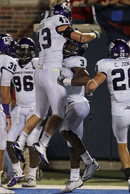DALLAS - SEPTEMBER 24:  Safety Tejay Johnson #3 of the TCU Horned Frogs celebrates his touchdown pass interception with Tank Carder #43 in the fourth quarter against the SMU Mustangs at Gerald J. Ford Stadium on September 24, 2010 in Dallas, Texas.  (Phot