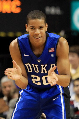 GREENSBORO, NC - MARCH 13:  Andre Dawkins #20 of the Duke Blue Devils claps while playing against the North Carolina Tar Heels during the first half in the championship game of the 2011 ACC men's basketball tournament at the Greensboro Coliseum on March 1