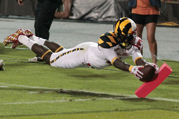 Ronnie Tyler dives across the pylon to give the Terps a 7-0 lead