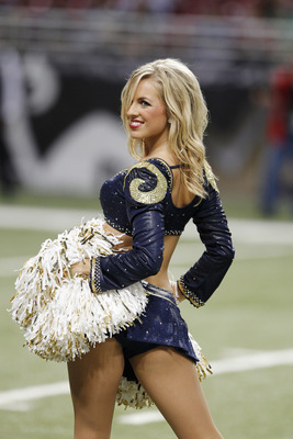 ST. LOUIS, MO - AUGUST 13: A St. Louis Rams cheerleader entertains the crowd during a timeout in the NFL preseason game against the Indianapolis Colts at Edward Jones Dome on August 13, 2011 in St. Louis, Missouri. The Rams defeated the Colts 33-10. (Phot