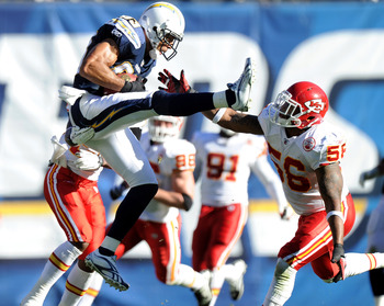 SAN DIEGO, CA - DECEMBER 12:  Vincent Jackson #83 of the San Diego Chargers makes a catch in the air in front of Derrick Johnson #56 of the Kansas City Chiefs during the first quarter at Qualcomm Stadium on December 12, 2010 in San Diego, California.  (Ph