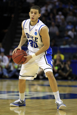 CHARLOTTE, NC - MARCH 20:  Seth Curry #30 of the Duke Blue Devils moves the ball while taking on the Michigan Wolverines during the third round of the 2011 NCAA men's basketball tournament at Time Warner Cable Arena on March 20, 2011 in Charlotte, North C