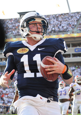 TAMPA, FL - JANUARY 1:  Quarterback Matt McGloin #11 of the Penn State Nittany Lions runs for a touchdown against the Florida Gators January 1, 2011 in the 25th Outback Bowl at Raymond James Stadium in Tampa, Florida.  (Photo by Al Messerschmidt/Getty Ima