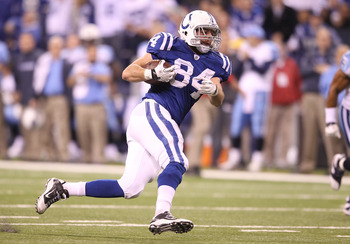 INDIANAPOLIS - JANUARY 02:  Jacob Tamme #84 of the Indianapolis Colts runs with the ball during NFL game against the Tennessee Titans at Lucas Oil Stadium on January 2, 2011 in Indianapolis, Indiana.  (Photo by Andy Lyons/Getty Images)