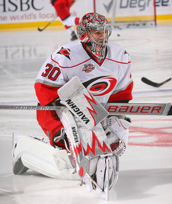 BUFFALO, NY - MARCH 15: Cam Ward #30 of the Carolina Hurricanes streches during warm ups prior to play against the Buffalo Sabres at HSBC Arena on March 15, 2011 in Buffalo, New York. Carolina won 1-0.  (Photo by Rick Stewart/Getty Images)