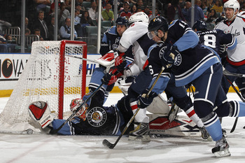 SUNRISE, FL - APRIL 9: Goaltender Tomas Vokoun #29 of the Florida Panthers stops a shot by Alex Ovechkin #8 of the Washington Capitals during the second period on April 9, 2011 at the BankAtlantic Center in Sunrise, Florida. (Photo by Joel Auerbach/Getty