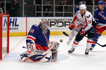 NEW YORK, NY - APRIL 17:  Goalie Henrik Lundqvist #30 of the New York Rangers makes a save against Marco Sturm #18 of the Washington Capitals in Game Three of the Eastern Conference Quarterfinals during the 2011 NHL Stanley Cup Playoffs at Madison Square