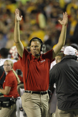 Randy Edsall celebrates a touchdown in Maryland's 32-24 win over Miami