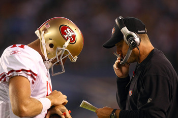 SAN DIEGO, CA - SEPTEMBER 1:  Head Coach Jim Harbaugh of the San Francisco 49ers speaks with Starting Quarterback Alex Smith #11 on the field during their preseason NFL Game against  the San Diego Chargers on September 1, 2011 at Qualcomm Stadium in San D