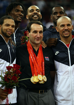 BEIJING - AUGUST 24:  (L-R)  Deron Williams #7, Chris Bosh #12, Carlos Boozer #4, Le Bron James #6 and Jason Kidd #5 of the United States pose for photos with head coach Mike Krzyzewski after defeating Spain in the gold medal game during Day 16 of the Bei