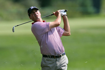 NORTON, MA - SEPTEMBER 03:  Matt Kuchar watches his shot form the fairway on the seventh hole during the second round of the Deutsche Bank Championship at TPC Boston on September 3, 2011 in Norton, Massachusetts.  (Photo by Jim Rogash/Getty Images)