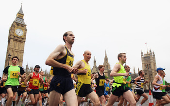 LONDON, ENGLAND - MAY 30:  50 invited club runners make their way past Big Ben and the Houses of Parliament on the LOCOG 2012 Test Event for the Marathon on the The Mall, on May 30, 2011 in London, England.  (Photo by Bryn Lennon/Getty Images)