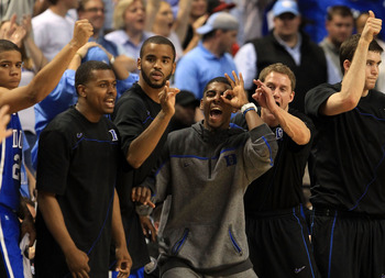 GREENSBORO, NC - MARCH 13:  Kyrie Irving #1 of the Duke Blue Devils celebrates with teammates on the bench during the second half in the championship game of the 2011 ACC men's basketball tournament at the Greensboro Coliseum on March 13, 2011 in Greensbo