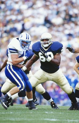 SOUTH BEND, IN - OCTOBER 15:  Oscar McBride #80 of the Notre Dame Fighting Irish looks to make a block during the game against the BYU Cougars at Notre Dame Stadium on October 15, 1994 in South Bend, Indiana. (Photo by Jonathan Daniel/Getty Images)