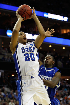 CHARLOTTE, NC - MARCH 18:  Andre Dawkins #20 of the Duke Blue Devils shoots the ball in front of Kwame Morgan II #32 of the Hampton Pirates in the first half during the second round of the 2011 NCAA men's basketball tournament at Time Warner Cable Arena o