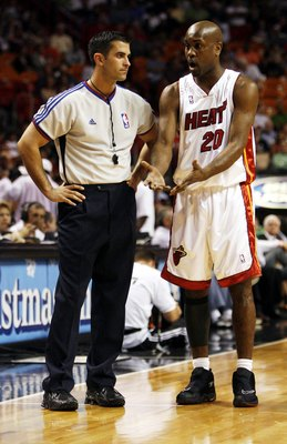 MIAMI - DECEMBER 13:  Guard Gary Payton #20 of the Miami Heat has a chat with Referee Zach Zarba during a break in the action against the Phoenix Suns on December 13, 2006 at the American Airlines Arena in Miami  Florida. NOTE TO USER: User expressly ackn