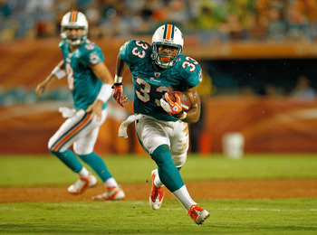 MIAMI GARDENS, FL - SEPTEMBER 01:  Daniel Thomas #33 of the Miami Dolphins runs with the ball during a Pre-Season NFL game against the Dallas Cowboys at Sun Life Stadium on September 1, 2011 in Miami Gardens, Florida.  (Photo by Mike Ehrmann/Getty Images)