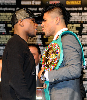 LAS VEGAS, NV - SEPTEMBER 14:  Boxers Floyd Mayweather Jr. (L) and Victor Ortiz face off during the final news conference for their bout at the MGM Grand Hotel/Casino September 14, 2011 in Las Vegas, Nevada. Mayweather will challenge Ortiz for the WBC wel
