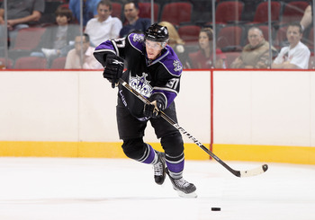 GLENDALE, AZ - SEPTEMBER 14:  Thomas Hickey #37 of the Los Angeles Kings skates with the puck during the NHL Rookie game against the Phoenix Coyotes at Jobing.com Arena on September 14, 2010 in Glendale, Arizona.  (Photo by Christian Petersen/Getty Images