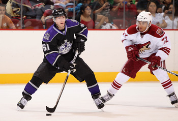 GLENDALE, AZ - SEPTEMBER 14:  Brandon Kozun #51 of the Los Angeles Kings skates with the puck under pressure from Charles Inglis #72 of the Phoenix Coyotes during the third period of the NHL Rookie game at Jobing.com Arena on September 14, 2010 in Glendal