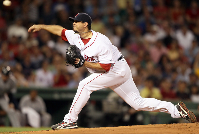 BOSTON, MA - AUGUST 31:  Josh Beckett #19 of the Boston Red Sox delivers a pitch in the second inning against the New York Yankees on August 31, 2011 at Fenway Park in Boston, Massachusetts.  (Photo by Elsa/Getty Images)