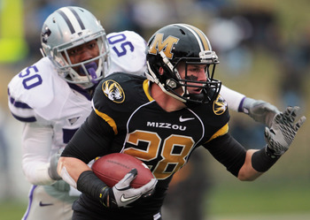 COLUMBIA, MO - NOVEMBER 13:  Receiver T.J. Moe #28 of the Missouri Tigers carries the ball as Tre Walker #50 of the Kansas State Wildcats defends during the game on November 13, 2010 at Faurot Field/Memorial Stadium in Columbia, Missouri.  (Photo by Jamie