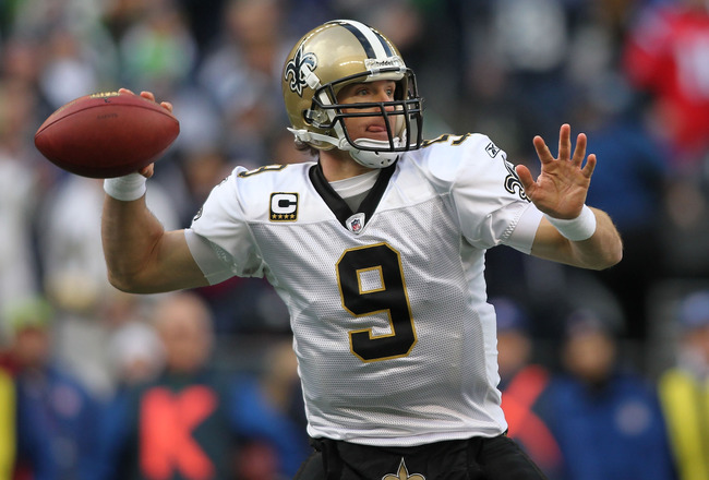SEATTLE, WA - JANUARY 08:  Quarterback Drew Brees #9 of the New Orleans Saints throws the ball in the second quarter against the Seattle Seahawks during the 2011 NFC wild-card playoff game at Qwest Field on January 8, 2011 in Seattle, Washington.  (Photo