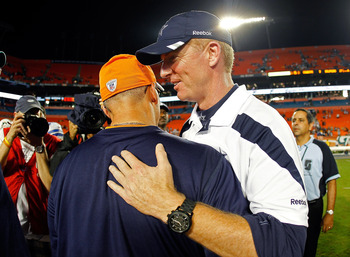 MIAMI GARDENS, FL - SEPTEMBER 01:  Dallas Cowboys head coach Jason Garrett shakes hands with Miami Dolphins head coach Tony Sparano after a Pre-Season NFL game against the at Sun Life Stadium on September 1, 2011 in Miami Gardens, Florida.  (Photo by Mike