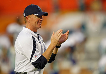 MIAMI GARDENS, FL - SEPTEMBER 01:  Dallas Cowboys head coach Jason Garrett greets teammates during a Pre-Season NFL game against the Miami Dolphins at Sun Life Stadium on September 1, 2011 in Miami Gardens, Florida.  (Photo by Mike Ehrmann/Getty Images)
