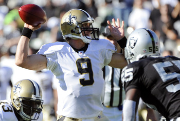 OAKLAND, CA - AUGUST 28:  Drew Brees #9 of the New Orleans Saints throws a pass against the Oakland Raiders in the first quarter during an NFL pre-season football game at the O.co Coliseum August 28, 2011 in Oakland, California. (Photo by Thearon W. Hende