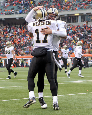 CINCINNATI, OH - DECEMBER 05:  Dree Brees #9 of the New Orleans Saints celebrates with Robert Meachem #17 after they connected for a touchdown pass during the NFL game against the Cincinnati Bengals at Paul Brown Stadium on December 5, 2010 in Cincinnati,