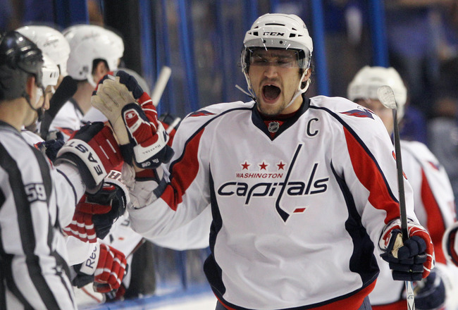 TAMPA, FL - MAY 03:  Alex Ovechkin #8 of the Washington Capitals celebrates a goal by Mike Knuble #22 (not shown) at 59 seconds of the second period against the Tampa Bay Lightning in Game Three of the Eastern Conference Semifinals during the 2011 NHL Sta