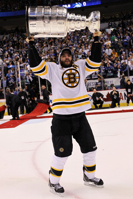 VANCOUVER, BC - JUNE 15:  Patrice Bergeron #37 of the Boston Bruins celebrates with the Stanley Cup after defeating the Vancouver Canucks in Game Seven of the 2011 NHL Stanley Cup Final at Rogers Arena on June 15, 2011 in Vancouver, British Columbia, Cana
